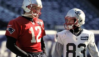 New England Patriots quarterback Tom Brady and receiver Wes Welker talk during practice at Gillette Stadium in Foxborough, Mass., Friday, Jan. 20, 2012. The Patriots will host the Baltimore Ravens in the AFC championship game on Sunday, Jan. 22. (AP Photo/Winslow Townson)