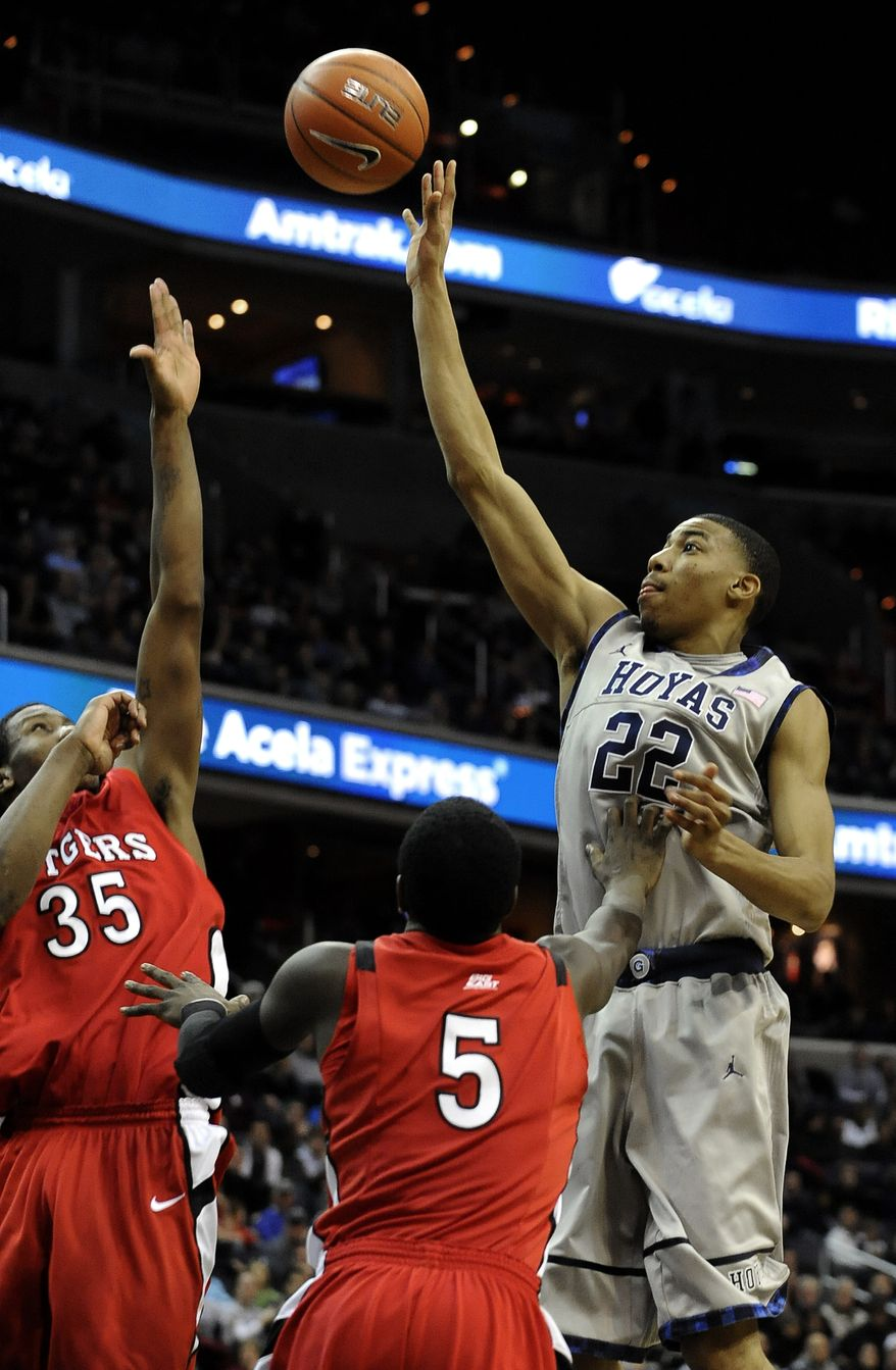 Georgetown's Otto Porter goes up for the shot against the defense of Rutgers' Eli Carter and Greg Lewis during the second half, Saturday, Jan. 21, 2012, in Washington. Georgetown defeated Rutgers 52-50 on two free throws by Porter in the final minute. (AP Photo/Richard Lipski)