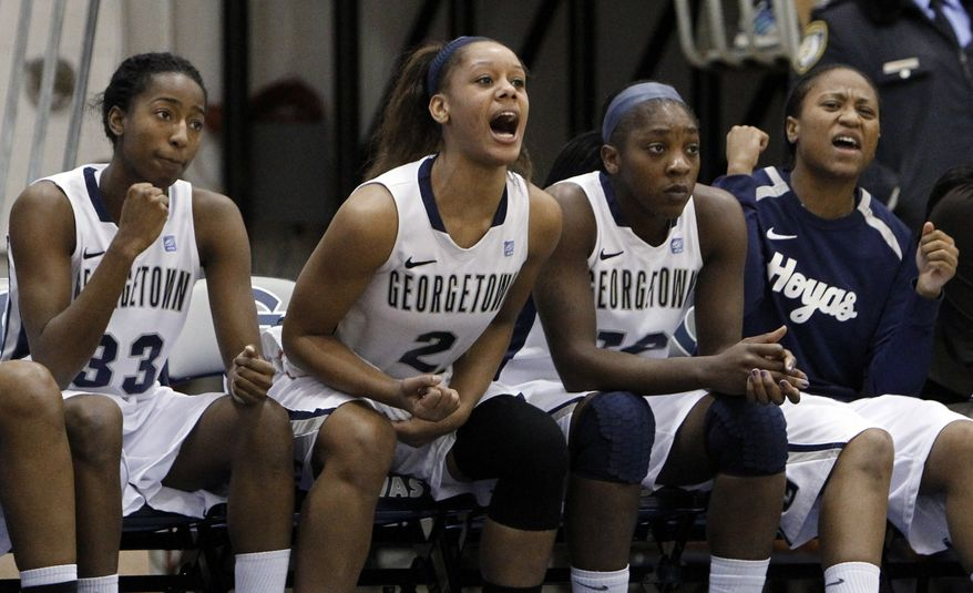 Georgetown forward Brittany Horne, left, forward Tia Magee (2) and others cheer their teammates from the bench during the second half against Syracuse in Washington, Sunday, Jan. 15, 2012. Georgetown beat Syracuse 69-42 and will play Louisville on Sunday. (AP Photo/Ann Heisenfelt)