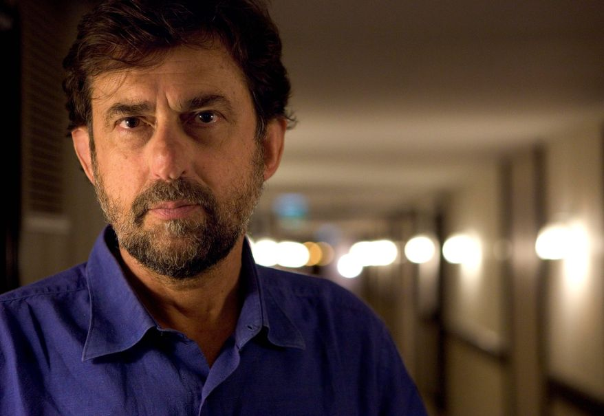 """FILE - In this Saturday, May 14, 2011 file photo Italian satirical filmmaker Nanni Moretti poses for a portrait during promotion for Habemus Papam at the 64th international film festival, in Cannes, southern France. Organizers of the Cannes Film Festival have chosen satirical Italian filmmaker Nanni Moretti to head the jury at this year's festival. The veteran actor and director of 2001 Palme d'Or winner """"The Son's Room"""" will head the jury for the May 16-27 festival on the French Riviera. (AP Photo/David Azia, File)"""