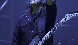 """""""I have a hand in both worlds. I love praise and worship music, and I love heavy metal,"""" says Megadeth  guitarist David Ellefson. (Associated Press)"""