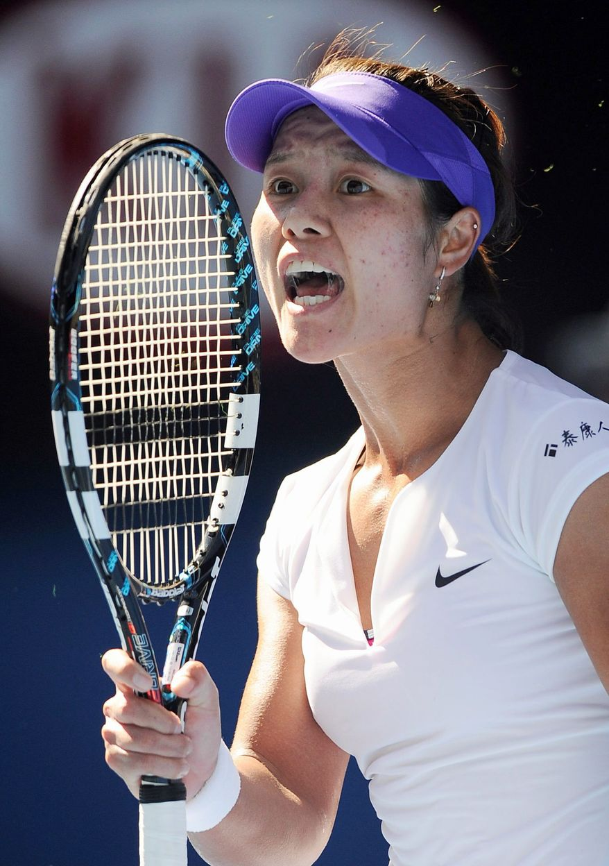 Li Na, the defending French Open champion, couldn't build on the momentum of winning the first set against Kim Clijsters. (Associated Press)
