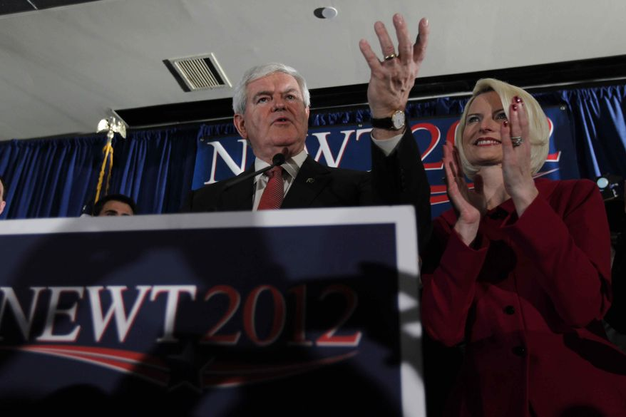 Former House Speaker Newt Gingrich, with wife Callista, speaks at a rally on Saturday night, Jan. 21, 2012, in Columbia, S.C., after Mr. Gingrich won the state's GOP presidential primary. (AP Photo/Matt Rourke)