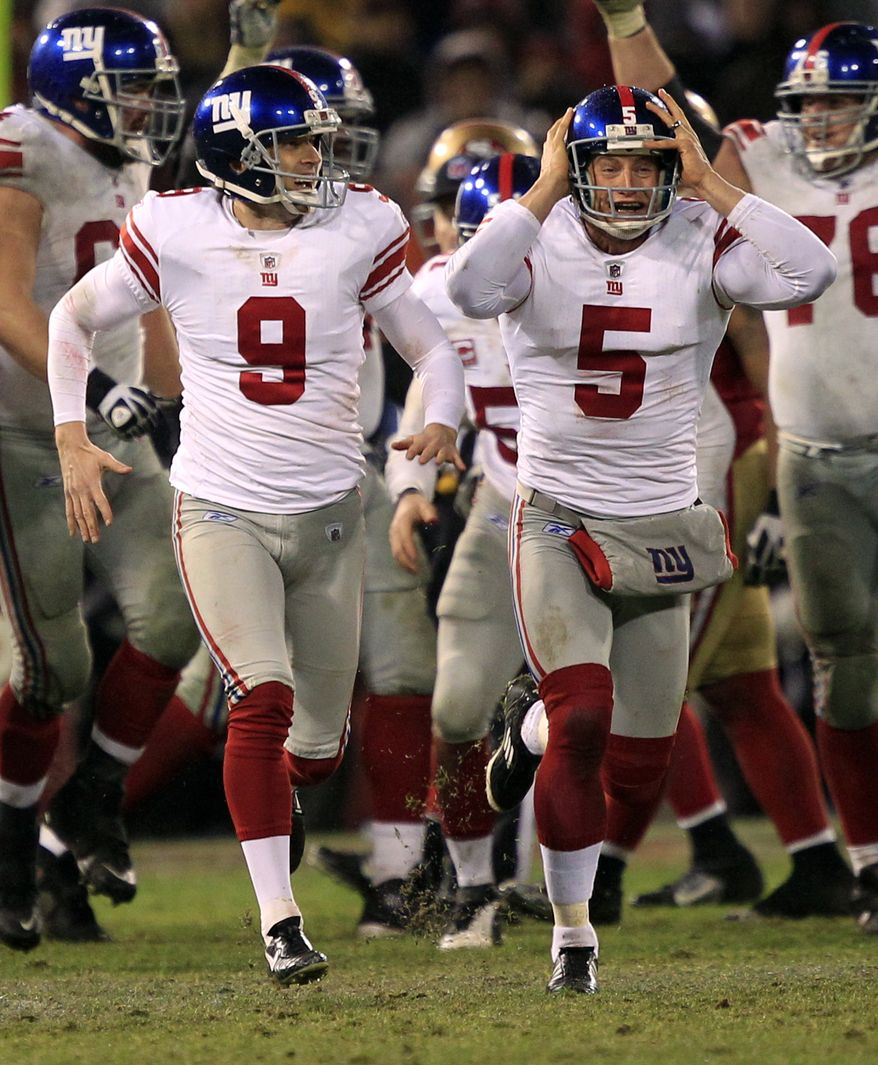New York Giants kicker Lawrence Tynes and punter Steve Weatherford celebrate after Tynes kicked the game-winning field goal during overtime Sunday, Jan. 22, 2012, in San Francisco. The Giants won 20-17 to advance to Super Bowl XLVI. (AP Photo/Marcio Jose Sanchez)