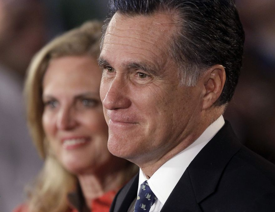 Former Massachusetts Gov. Mitt Romney, with his wife, Ann, speaks at his primary election night reception at the South Carolina State Fairgrounds in Columbia, S.C., on Saturday, Jan. 21, 2012. (AP Photo/Charles Dharapak)