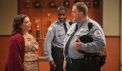 "Melissa McCarthy and Billy Gardell (right) trade raunchy one-liners as Reno Wilson looks on in a scene from ""Mike & Molly,"" one of four Monday night CBS sitcoms. (CBS Entertainment via Associated Press)"