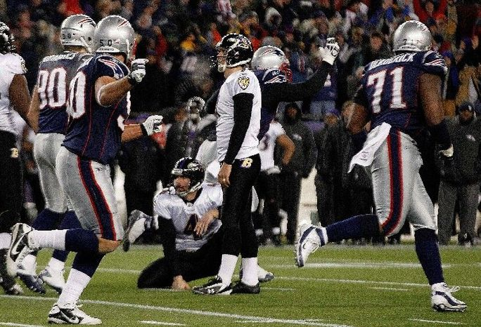 Baltimore kicker Billy Cundiff (center) could have forced overtime at New England in the AFC title game Sunday, but his 32-yard field goal attempt in the waning seconds was wide left. (Associated Press)