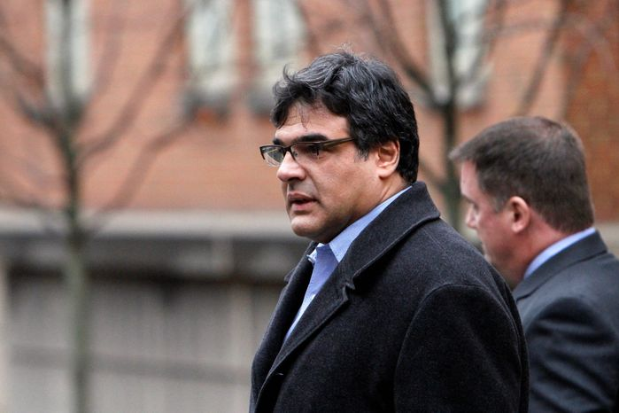 Former CIA officer John Kiriakou (left) and his attorney, John Hundley, leave federal court in Alexandria. In the latest criminal case in the Obama administration's effort to punish leakers, Mr. Kiriakou was charged Monday with disclosing classified information to the media. (Associated Press)