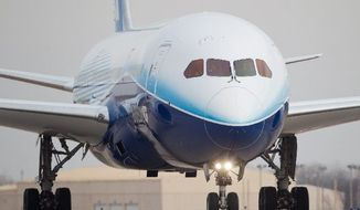 A Boeing 787 lands at McConnell Air Force Base in Wichita, Kan., on Friday. Boeing is building its 787 Dreamliner to use 20 percent less fuel than the jet it replaces. (Associated Press)