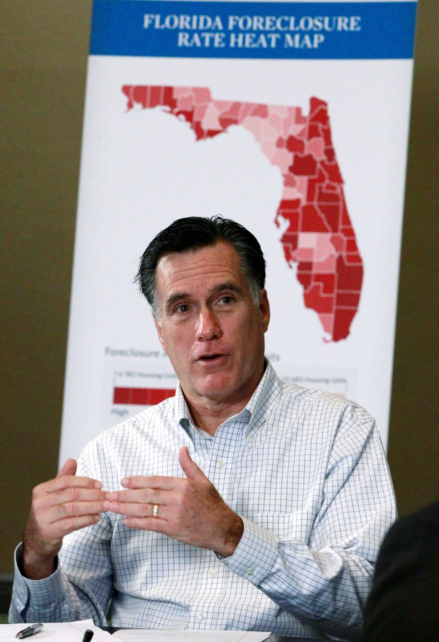 Former Massachusetts Gov. Mitt Romney, a GOP presidential hopeful, holds a discussion on housing and foreclosure in Tampa, Fla., on Monday. Mr. Romney slammed former House Speaker Newt Gingrich for his work with Freddie Mac and called on him to release records from an ethics investigation. (Associated Press)