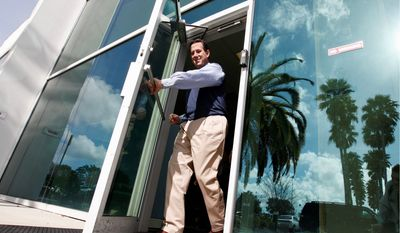 Former Sen. Rick Santorum of Pennsylvania, a Republican presidential candidate, leaves PGT Industries in North Venice, Fla., on Monday. He is in Florida stumping ahead of next week's primary in which 50 delegates are on the line. The candidates are trading bitter blows on the campaign trail. (Associated Press)