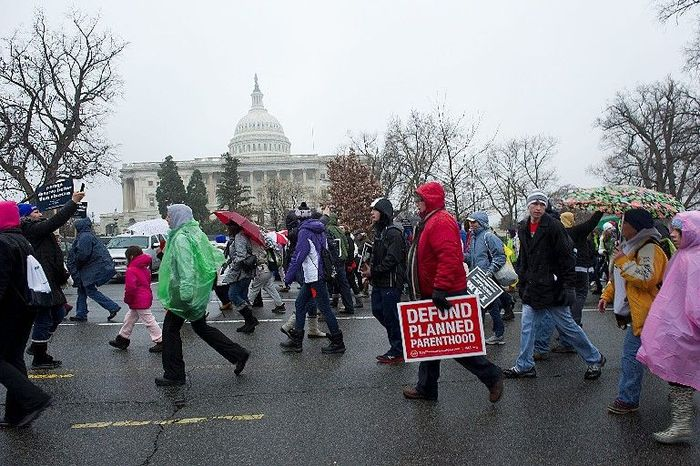 ** FILE ** In this Jan. 23, 2012, file photo, pro-life advocates march past the Capitol during the annual M