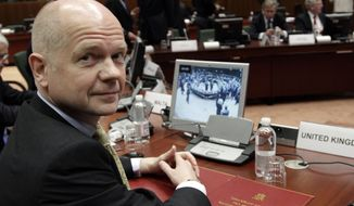 British Foreign Minister William Hague waits for the start of a meeting of European Union foreign ministers at the EU Council building in Brussels on Monday, Jan. 23, 2012. (AP Photo/Virginia Mayo)