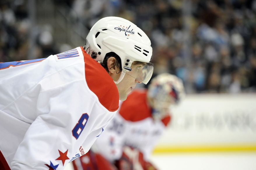 Washington Capitals left wing Alex Ovechkin (8) lines up for a face-off during the second period of an NHL hockey game against the Pittsburgh Penguins on Sunday, Jan. 22, 2012, in Pittsburgh. Pittsburgh won 4-3 in overtime. (AP Photo/Don Wright)
