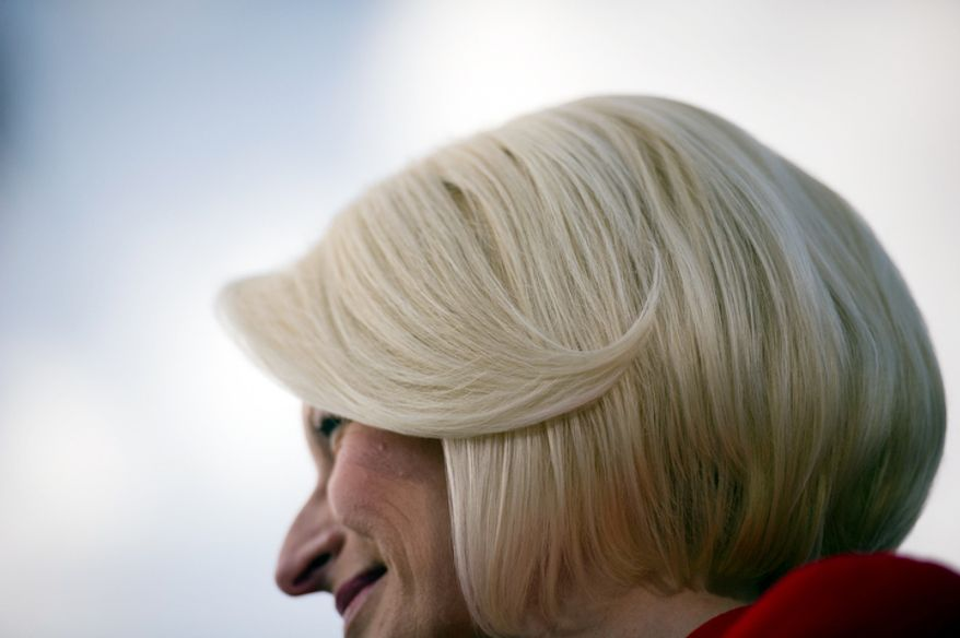 Callista Gingrich appears on stage with her husband, Republican presidential candidate and former House Speaker Newt Gingrich in Tampa, Fla. (Rod Lamkey Jr/ The Washington Times)