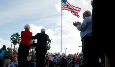 With the Florida presidential primary just over a week away, Republican presidential candidate and former House Speaker Newt Gingrich is joined by his wife Callista at The River at Tampa Bay Church. (Rod Lamkey Jr/ The Washington Times)