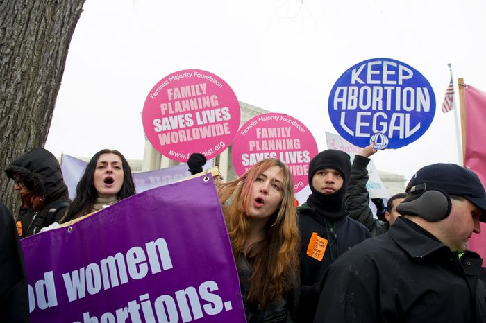 **FILE** Pro-choice advocates, including (from left), Yasemin Ayarci of Levittown, Penn., Emma Studnick of New York, N.Y., and Michael Patterson of Anchorage, Alaska, chant pro-choice slogans Jan. 23, 2012, in front of the U.S. Supreme Court. (Barbara L. Salisbury/The Washington Times)