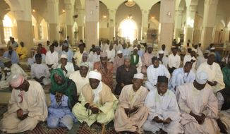 Muslim men at a mosque in Kano, Nigeria, pray on Monday, Jan. 23, 2012, for peace and for people who lost their lives during attacks over the weekend. (AP Photo/Sunday Alamba)