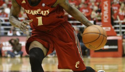 Cincinnati guard Cashmere Wright in action against Villanova in an NCAA basketball game, Saturday, Jan. 14, 2012, in Cincinnati. (AP Photo/Al Behrman)