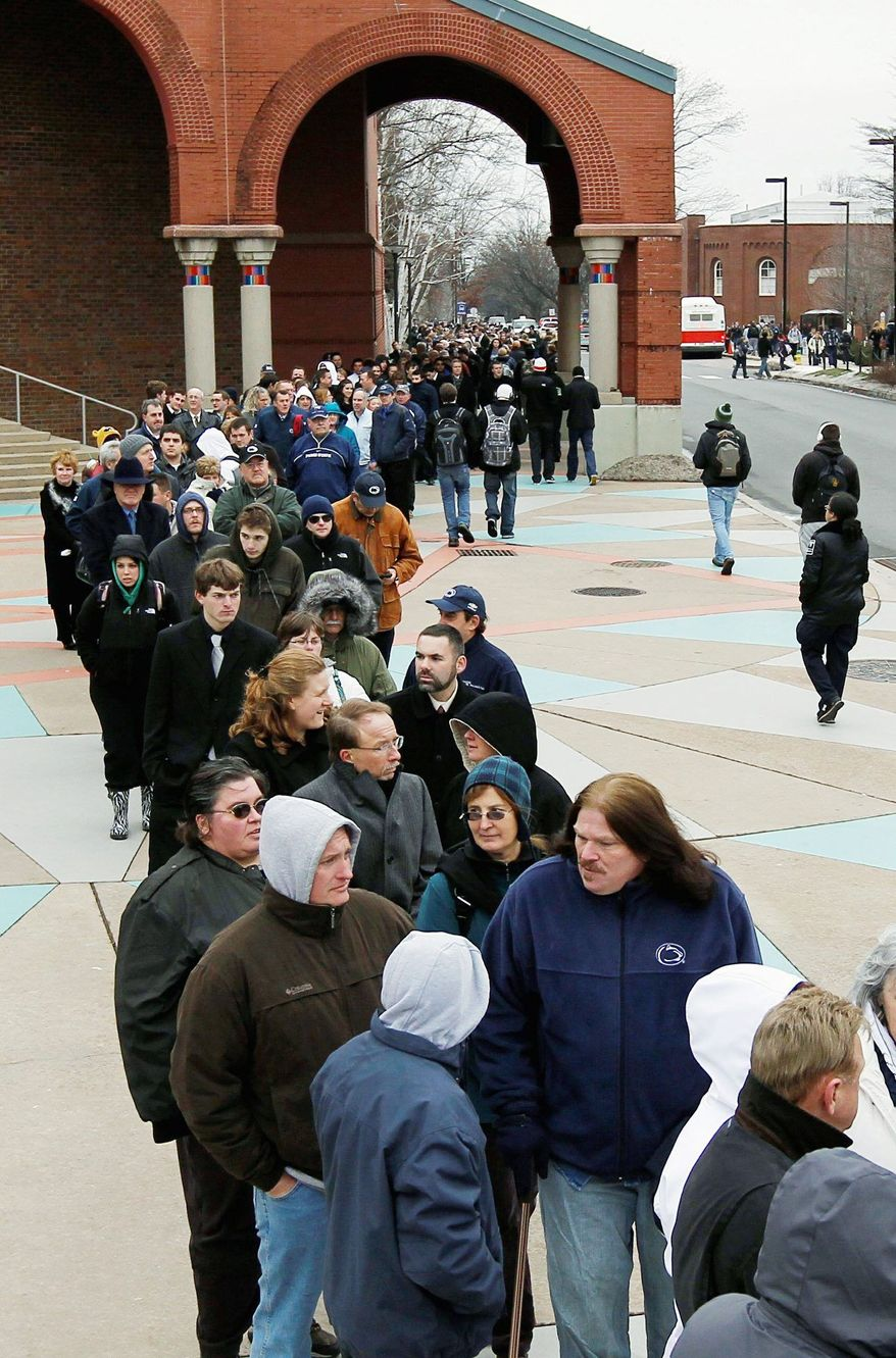 Mourners wait in line on campus Tuesday to view the casket of former Penn State head coach Joe Paterno, who died Sunday of lung cancer at age 85. (Associated Press)