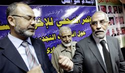 """Nobody can force me"" to sit with Israelis, says Muslim Brotherhood leader Mahmoud Ezzat (left). He and Brotherhood leader Mohammed Badie appeared for a news conference last year in front of a banner that reads, ""Islam is the answer."" (Associated Press)"