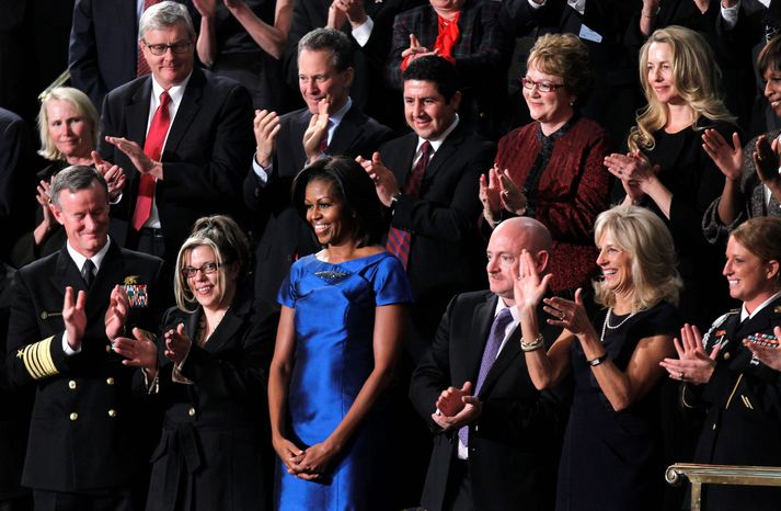 First lady Michelle Obama stands among several guests of the White House at the State of the Union address in this 2012 file photo. In the front row (from left) are Adm. William McRaven; Jackie Bray; Mrs. Obama; retired Navy Capt. Mark Kelly; Jill Biden, wife of the vice president; and Sgt. Ashleigh Berg. Two of the celebrity guests wer