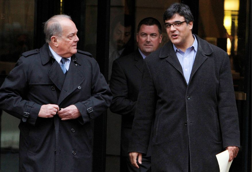 Former CIA officer John Kiriakou (right) and his attorneys, Plato Cacheris (left) and John Hundley, leave federal court Monday in Alexandria. In the latest criminal case in the Obama administration's effort to punish leakers, Mr. Kiriakou was charged Monday with disclosing classified secrets about his teammates to the media. (Associated Press)