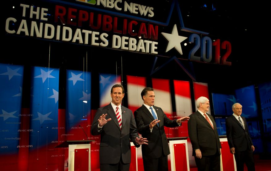 Republican presidential candidates (left to right): former Pennsylvania Senator Rick Santorum, former Massachusetts Governor Mitt Romney,  former House Speaker Newt Gingrich and Rep. Ron Paul (R-Tex) arrive on stage prior to their participation in The Republican Candidates Debate at the University of South Florida in Tampa, Fla., Monday, January 23, 2012. (Rod Lamkey Jr/ The Washington Times)