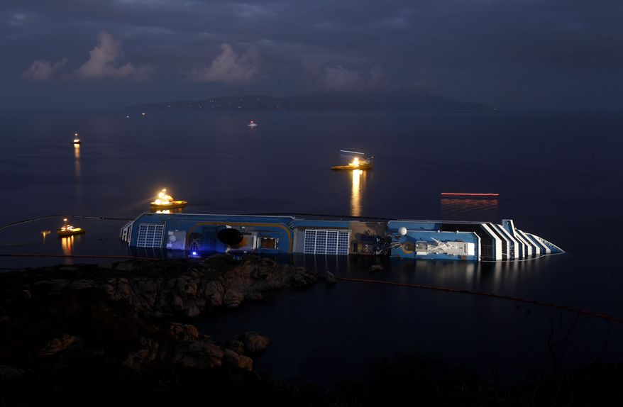 The grounded cruise ship Costa Concordia lies Jan. 23, 2012, on its side off the Tuscan island of Giglio, Italy. (Associated Press)