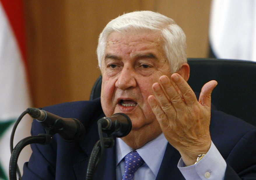 Syrian Foreign Minister Walid al-Moallem speaks during a press conference in Damascus, Syria, on Tuesday, Jan. 24, 2012. (AP Photo/Muzaffar Salman)