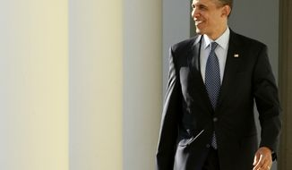 On the day of his State of the Union address, President Obama walks Jan. 24, 2012, from the Oval Office along the Colonnade of the White House. (Associated Press)