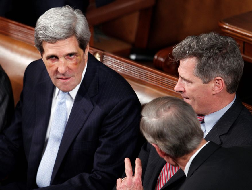 Sen. John Kerry, D-Mass., left, talks with Sen. Scott Brown, R-Mass., right, and Sen. Thomas Carper, D-Del., prior to the start of President Barack Obama's State of the Union address. Kerry recently suffered a broken nose while playing hockey.  (AP Photo/Evan Vucci)