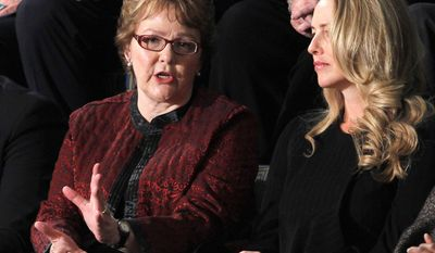 Bershire Hathaway Assistant Debbie Bosanek, left, talks with Steve Jobs widow Laurene Powell Jobs, prior to President Barack Obama's State of the Union address. (AP Photo/Pablo Martinez Monsivais)
