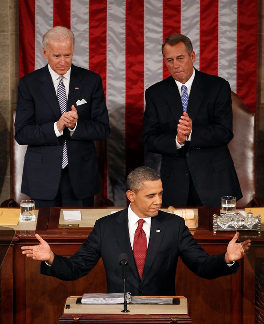 Vice President Joe Biden and House Speaker John Boehner of Ohio applaud President Barack Obama as the president gives his State of the Union address. (AP Photo/J. Scott Applewhite)