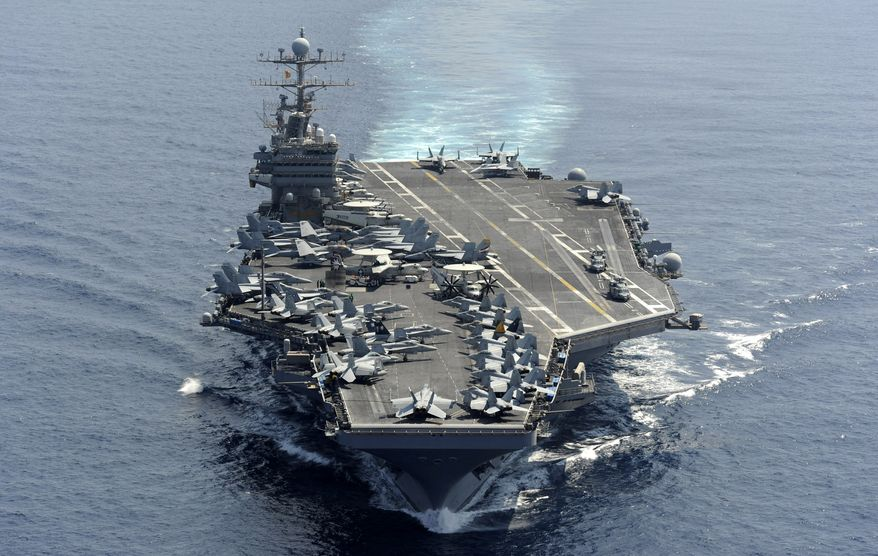The aircraft carrier USS Abraham Lincoln transits the Indian Ocean on Jan. 18, 2012. (AP Photo/U.S. Navy)