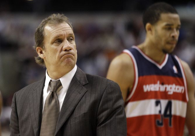 ** FILE ** In this Jan. 13, 2012, file photo, Washington Wizards coach Flip Saunders looks on during an NBA game against the Philadelphia 76ers in Philadelphia. Saunders was fired as coach of the Wizards, who have the NBA's worst record at 2-15. (AP Photo/Matt Slocum, File)