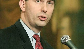 Wisconsin Gov. Scott Walker has a 51 percent approval rating, according to a Marquette University Law School poll, as he faces a recall effort. (Associated Press)