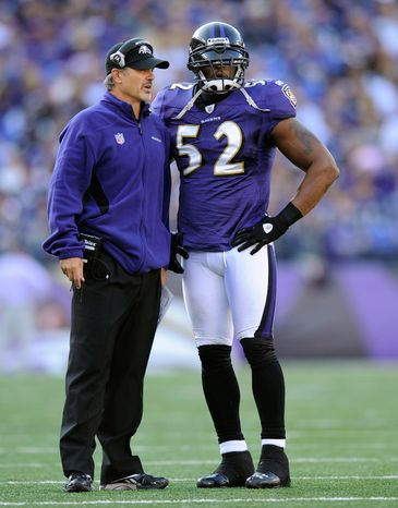 Chuck Pagano, shown with Baltimore linebacker Ray Lewis, will coach an Indianapolis team that has the No. 1 overall draft pick in Ap