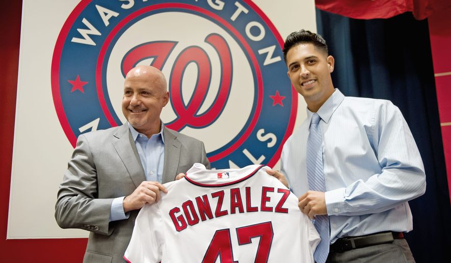 Washington Nationals general manager Mike Rizzo traded four top prospects to the Oakland Athletics for right-hander Gio Gonzalez, who was introduced at Nationals Park on Wednesday. (Andrew Harnik/The Washington Times)