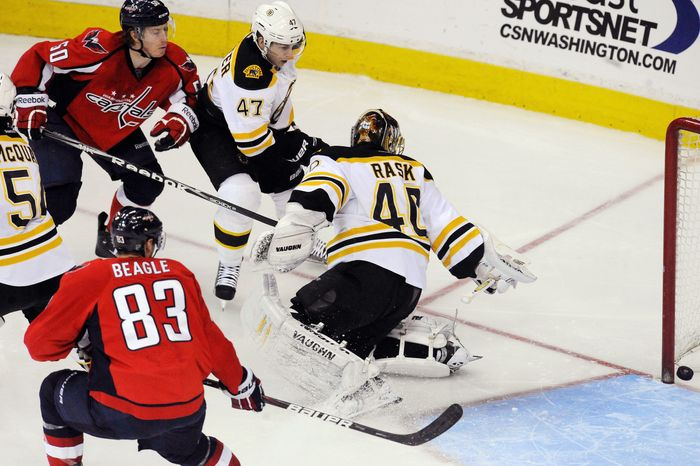 Capitals center Cody Eakin (upper left) watches as his shot beats Boston goalie Tuukka Rask in Washington's 5-3 win at Verizon Center on Tuesday night. (Associated Press)