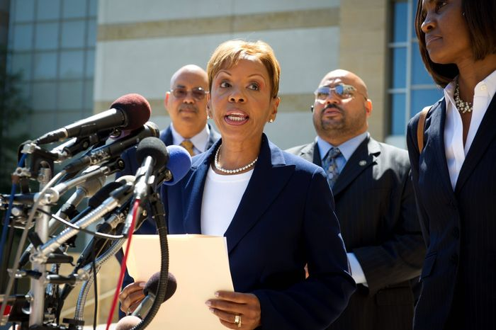 Prince George's County Council member Leslie Johnson makes a statement to reporters in June after pleading guilty to conspiring to obstruct a federal corruption investigation. She initially said she would keep her council seat until sentencing, which was her right, but she was pressured into resigning at the end of July. (Rod Lamkey Jr./The Washington Times)
