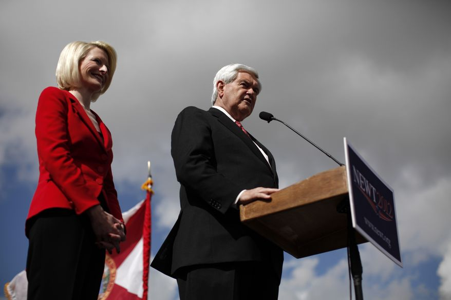 Republican presidential candidate and former House Speaker Newt Gingrich, accompanied by his wife Callista, speaks Jan. 25, 2012, at Wings Plus Restaurant in Coral Springs, Fla. (Associated Press)