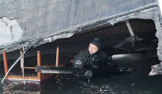 A scuba diver makes his way into a flooded cabin of the grounded Costa Concordia cruise ship off the Tuscan island of Giglio, Italy, in this undated photo. (AP Photo/Italian navy GOS)