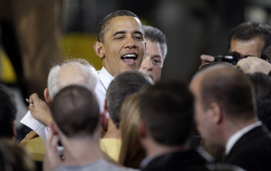 President Obama is greeted Jan. 25, 2012, at the Conveyor Engineering & Manufacturing plant in Cedar Rapids, Iowa, after speaking about manufacturing jobs. (Associated Press)