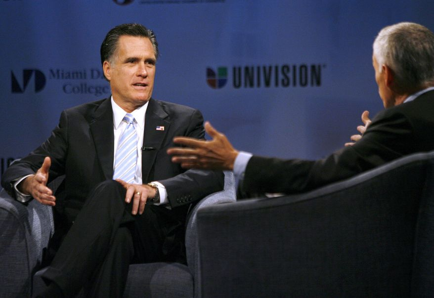 """Republican presidential candidate and former Mass. Gov. Mitt Romney speaks Jan. 25, 2012, with Univision News anchor Jorge Ramos at the """"Meet the Candidates"""" event, hosted by Univision at Miami Dade College in Miami. (Associated Press)"""