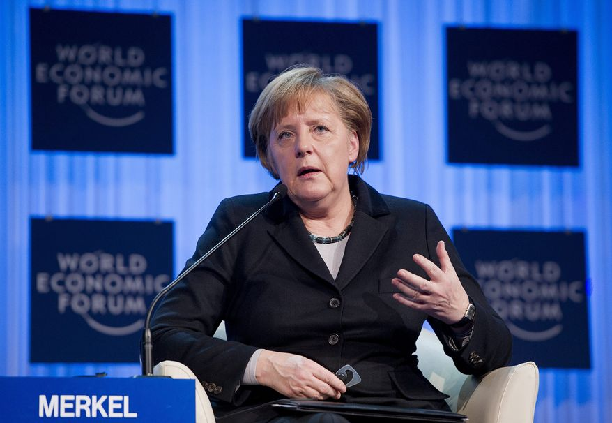 German Chancellor Angela Merkel speaks during the opening session of the World Economic Forum in Davos, Switzerland, on Wednesday, Jan. 25, 2012. (AP Photo/Keystone, Jean-Christophe Bott)