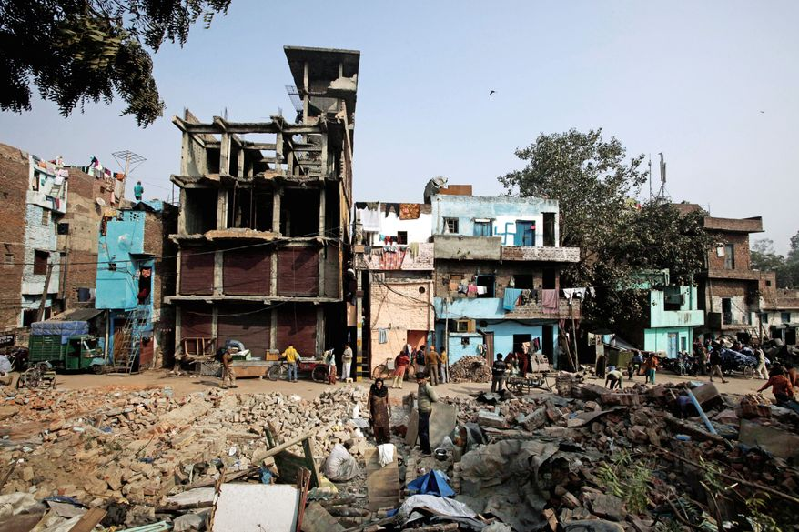 Residents retrieve belongings in December after authorities demolished their unauthorized houses in northeastern Delhi, which contains India's most crowded neighborhoods. Some homes are made of a single layer of brick, with extra floors added without support for the weight. Below, narrow streets are lined by buildings jammed together. Experts say a major earthquake is likely to hit the city, but next to nothing has been done to prepare for it, in part because of poverty. (Associated Press)