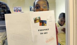 A Tyler Elementary School student holds a program for a young artists exhibition at the Phillips Collection. The gallery shows D.C. students' artwork in its new wing. (James R. Brantley/Special to The Washington Times)