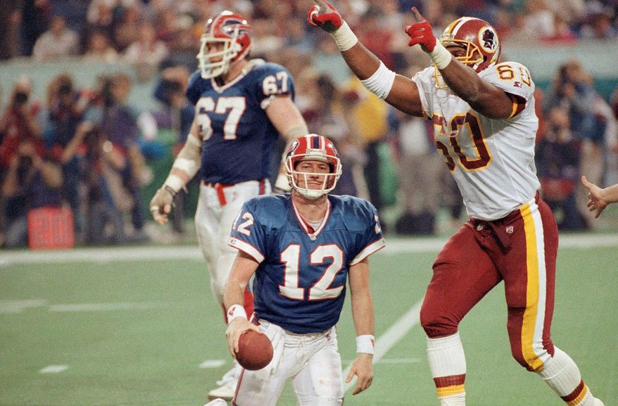 Washington Redskins' Fred Stokes, right, celebrates after sacking Buffalo Bills quarterback Jim Kelly in the third quarter of Super Bowl XXVI in Minneapolis, Sunday, Jan. 26, 1992. At left rear is Bills Kent Hull. The Redskins defeated the Bills 37-24. (AP Photo/Jim Mone)