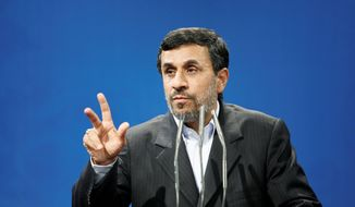Iranian President Mahmoud Ahmadinejad denied Thursday that an embargo on Iranian oil and sanctions against the central bank would affect his country's economy, but he also said he is open to nuclear-program talks with the West. (Associated Press)